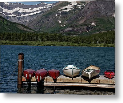 Red Canoes On The Lake Metal Print by Sandra Anderson