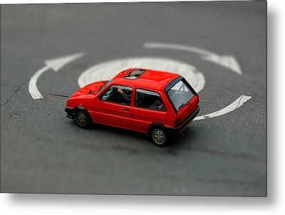 Red Car In Roundabout. Metal Print by Rob Huntley