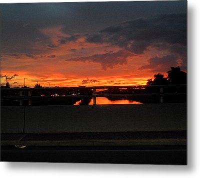 Red Sunset Metal Print by Val Oconnor