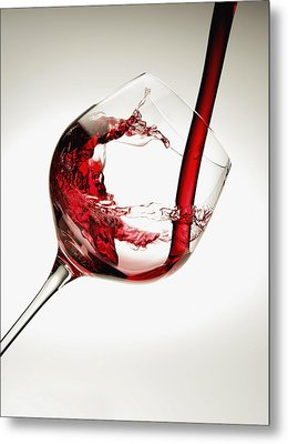 Red Wine Pouring Into A Glass Metal Print by Richard Desmarais