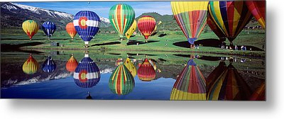 Reflection Of Hot Air Balloons On Metal Print by Panoramic Images