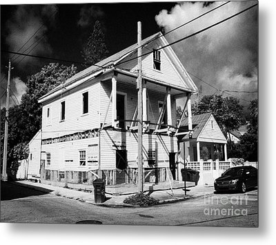 Repairs To Traditional Two Storey Wooden House In The Old Town Of Key West Florida Usa Metal Print by Joe Fox
