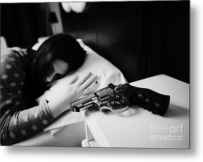 Revolver Handgun On Bedside Table Of Early Twenties Woman In Bed In A Bedroom Metal Print by Joe Fox