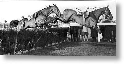 Riderless Horses Take Jump Metal Print by Underwood Archives