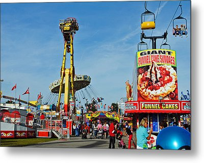 Rides Rides Rides Metal Print by Skip Willits