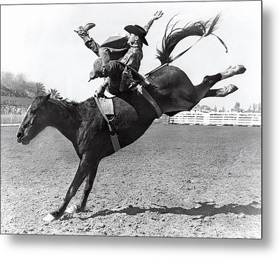 Riding A Bucking Bronco Metal Print by Underwood Archives