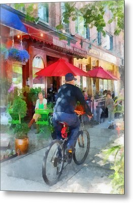 Riding Past The Cafe Metal Print by Susan Savad