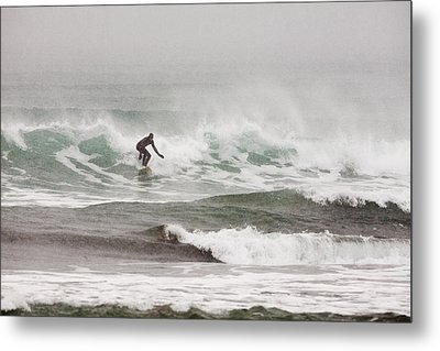 Riding The Waves In A Snow Storm Metal Print by Tim Grams