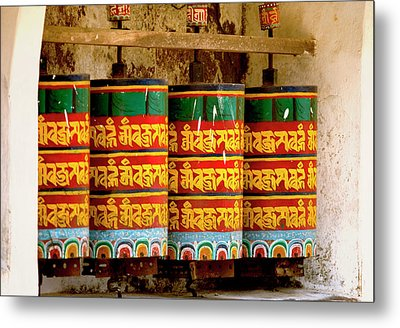 Ritual Prayer Wheels At A Buddhist Metal Print by Jaina Mishra