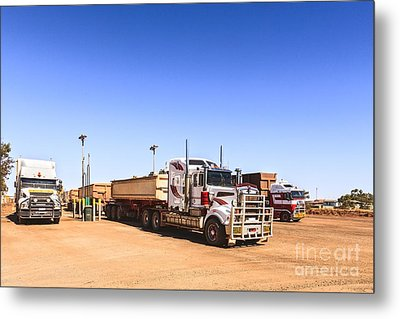 Road Trains Refuelling Metal Print by Colin and Linda McKie