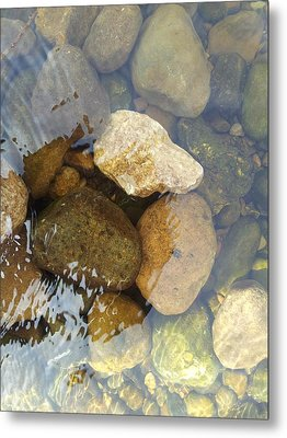 Rock And Pebbles Metal Print by David Stribbling
