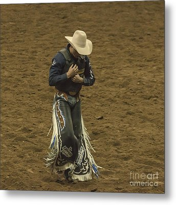 Rodeo Cowboy Dusting Off Metal Print by Janice Rae Pariza