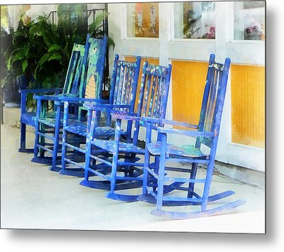 Row Of Blue Rocking Chairs Metal Print by Susan Savad