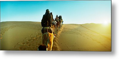 Row Of People Riding Camels Metal Print