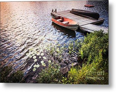 Rowboat At Lake Shore At Sunrise Metal Print by Elena Elisseeva
