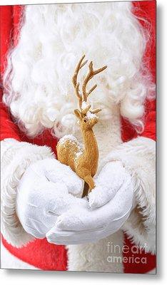 Santa Holding Reindeer Figure Metal Print by Amanda Elwell