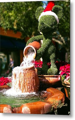 Metal Print featuring the photograph Santa Mickey Topiary Fountain by Doug Kreuger