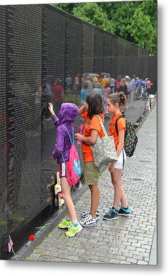 Searching A Loved Ones Name On The Vietnam Veterans Memorial Metal Print by Jim Fitzpatrick