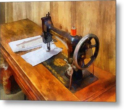 Sewing Machine With Orange Thread Metal Print by Susan Savad