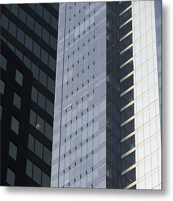 Side Of An Office Towers With Glass Metal Print by Keith Levit