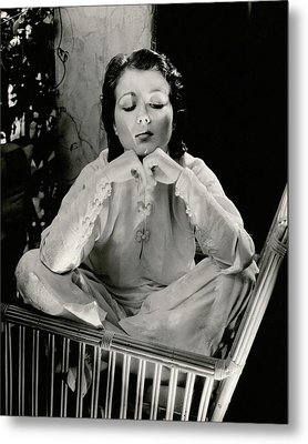 Sidney Fox Sitting On A Bamboo Chair Metal Print