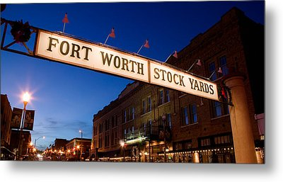 Signboard Over A Road At Dusk, Fort Metal Print by Panoramic Images