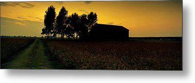 Silhouette Of A Farmhouse At Sunset Metal Print by Panoramic Images