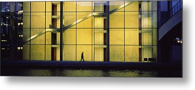 Silhouette Of A Person Walking In Front Metal Print by Panoramic Images