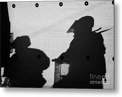 Silhouette Of British Army Soldiers On Screen On Crumlin Road At Ardoyne Shops Belfast 12th July Metal Print by Joe Fox