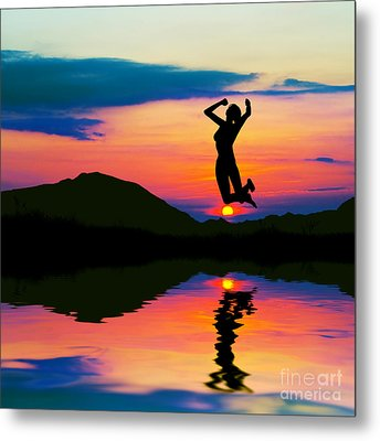 Silhouette Of Happy Woman Jumping At Sunset Metal Print