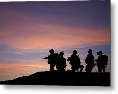 Silhouette Of Modern Troops In Middle East Silhouette Against Be Metal Print by Matthew Gibson