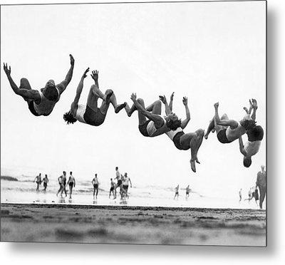 Six Men Doing Beach Flips Metal Print by Underwood Archives