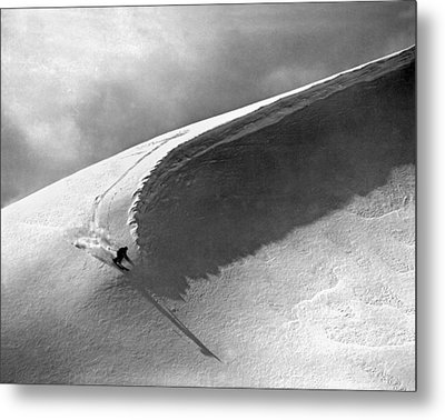 Skiing Under A Curl Metal Print by Underwood Archives