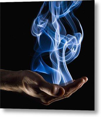 Smoke Wisps From A Hand Metal Print by Corey Hochachka