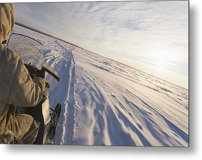 Snowmachiner Following Trail On Frozen Metal Print by Kevin Smith