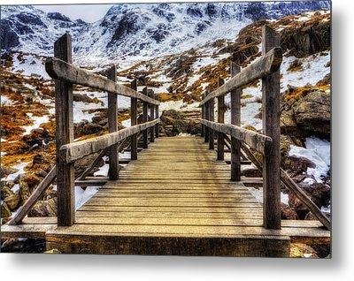 Snowy Footbridge Metal Print by Ian Mitchell
