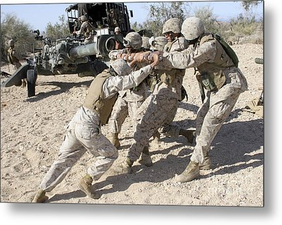 Soldiers Move The Muzzle-end Of A M777 Metal Print by Stocktrek Images