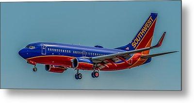 Southwest 737 Landing Metal Print by Paul Freidlund