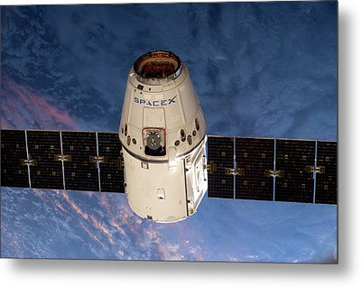 Spacex Dragon Capsule At The Iss Metal Print by Nasa
