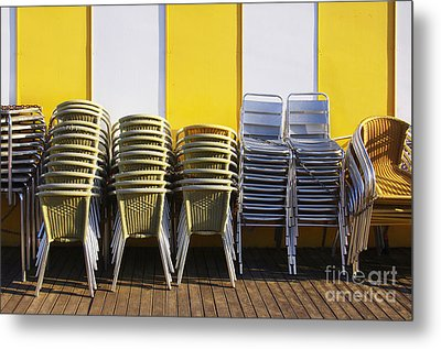 Stacks Of Chairs And Tables Metal Print by Carlos Caetano