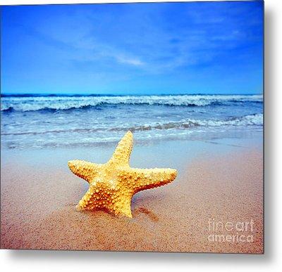 Starfish On A Beach   Metal Print by Michal Bednarek