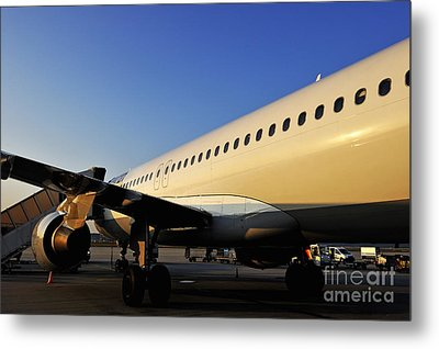 Stationary Airplane On Tarmac At Sunrise Metal Print