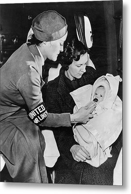 Stewardess Feeding Baby Metal Print by Underwood Archives