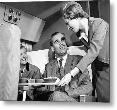 Stewardess Serving Food Metal Print by Underwood Archives