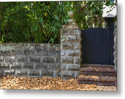 Stone Wall And Gate Metal Print by Rich Franco