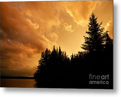 Storm Clouds At Sunset Metal Print by Larry Ricker