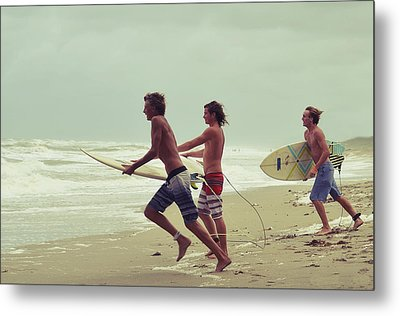 Storm Surfers Metal Print by Laura Fasulo