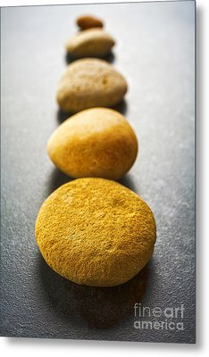 Straight Line Of Brown Pebbles On Dark Background Metal Print