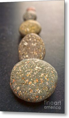 Straight Line Of Speckled Grey Pebbles On Dark Background Metal Print by Colin and Linda McKie