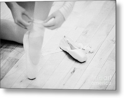 Student Putting On Pointe Shoes At A Ballet School In The Uk Metal Print by Joe Fox
